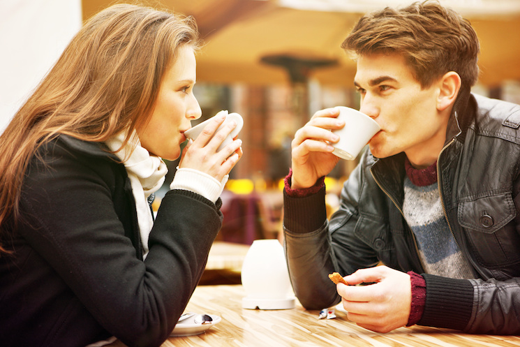 A picture of a young couple drinking coffee in a restaurant