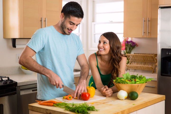 Young fit lovers making health food for lunch and dinner to keep in shape